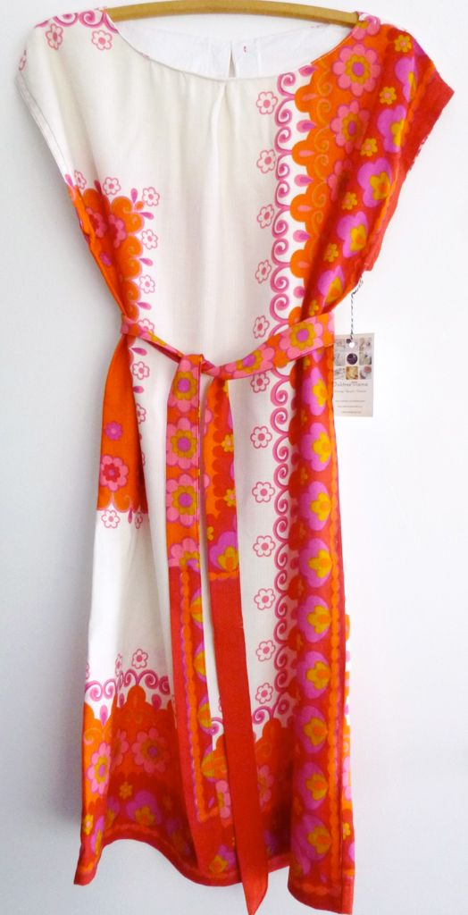 Day Ten: Oaktree Mama has caught our eye before with her simply stunning summery frocks, carefully upcycled from top quality vintage table linens. This one has a gorgeous seventies white and orange, pink and red floral design in a polyester cotton that's super soft from its previous life as a hardworking tablecloth.