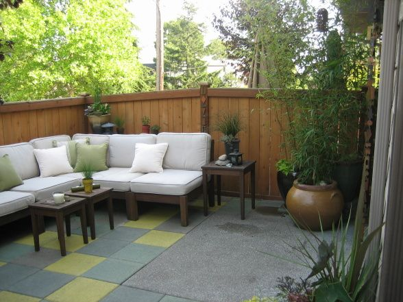 Patio oasis small townhouse backyard turned into an outdoor living space using custom stained - How to create a small outdoor oasis ...
