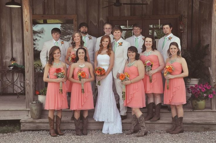 Coral and mint wedding. Coral bridesmaid dresses. Mint groomsmen ties. Cowboy boots. Tan and white seersucker suits. Lace bridal gown.  #rustic #wedding #photography