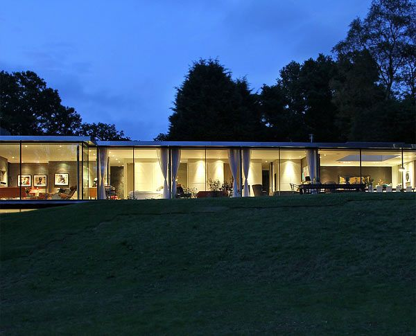 Modern glass house in Surrey.  Love the curtain treatment on windows