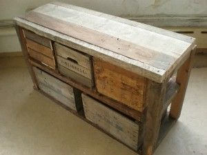 Work bench into rustic storage with re-purposed crates.