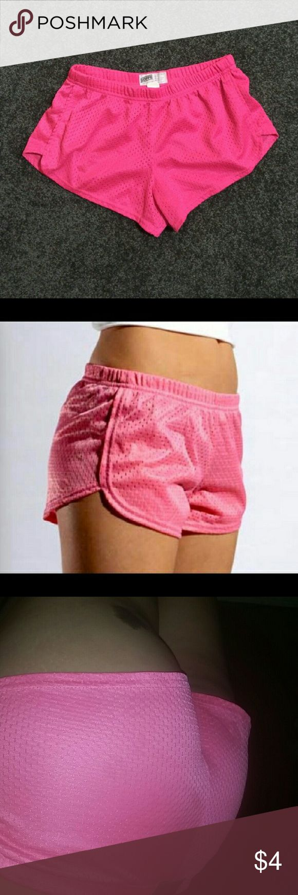 Hot pink shorts Hot pink shorts. Uses are for cheer practice, working out and anything else you want them for.   Used maybe 3?'s MAX. Too small for me.   Size is a small but fits like a XS.  In good condition. Soffe Shorts