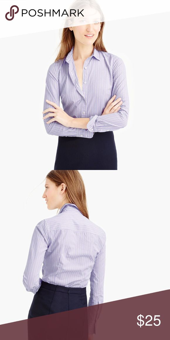 """NWOT J Crew Perfect Stripe Shirt """"The perfect shirt for work & beyond. With precisely placed busy and back princess darts for a slimming, waist-defining fit. Crafted from lightweight cotton. Functional buttons at cuffs. Body length approx 26.5""""                                                 Selling in purple and white pinstripe, NOT the black and white shown in the stock images. J Crew factory. J. Crew Factory Tops Button Down Shirts"""