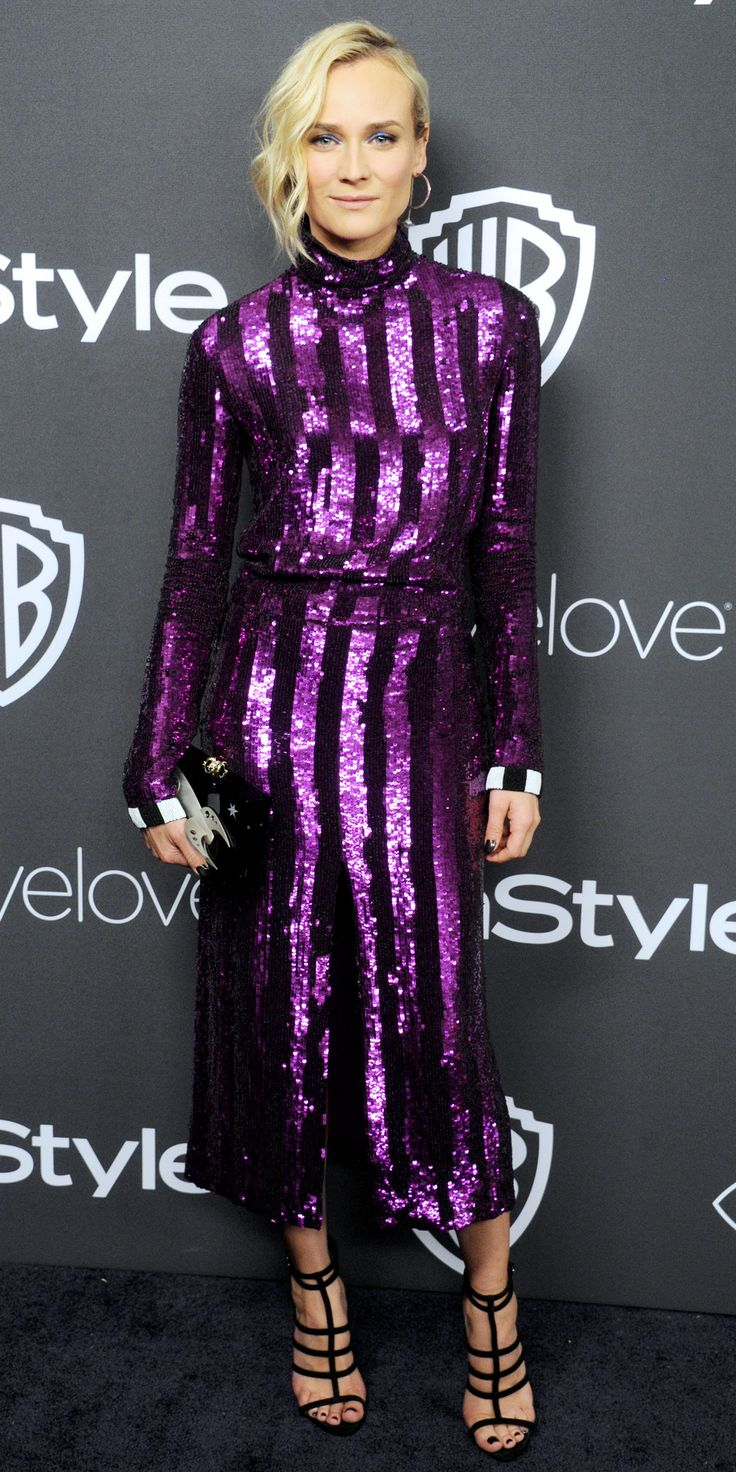 Diane Kruger lit up the 18th Annual Warner Bros x InStyle Golden Globes after-party in a purple sequin striped Nina Ricci design, styled with a whimsical rocket ship-motif Charlotte Olympia clutch, black strappy sandals, a heart-shaped Swarovski stud, and a hoop-slash-pearl drop earring.