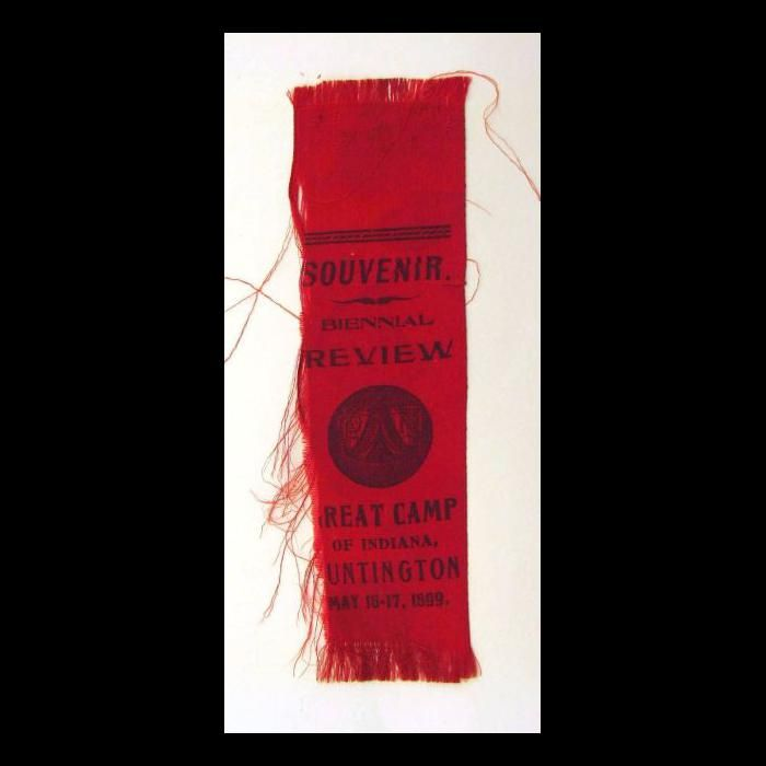 Knights of the Maccabees ribbon. Red silk ribbon is stamped with the circular logo of the Knights of the Maccabees in black ink in the center.
