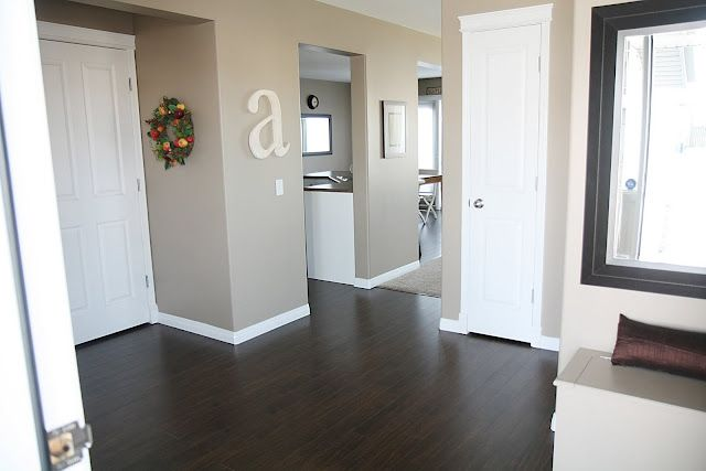 Dark wood floors white trim and doors wall color it 39 s Paint colors that go with grey flooring