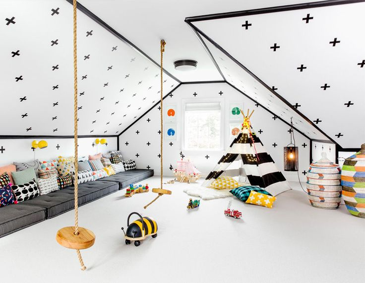From Domino Amazing playroom! Love the French piped mattresses.