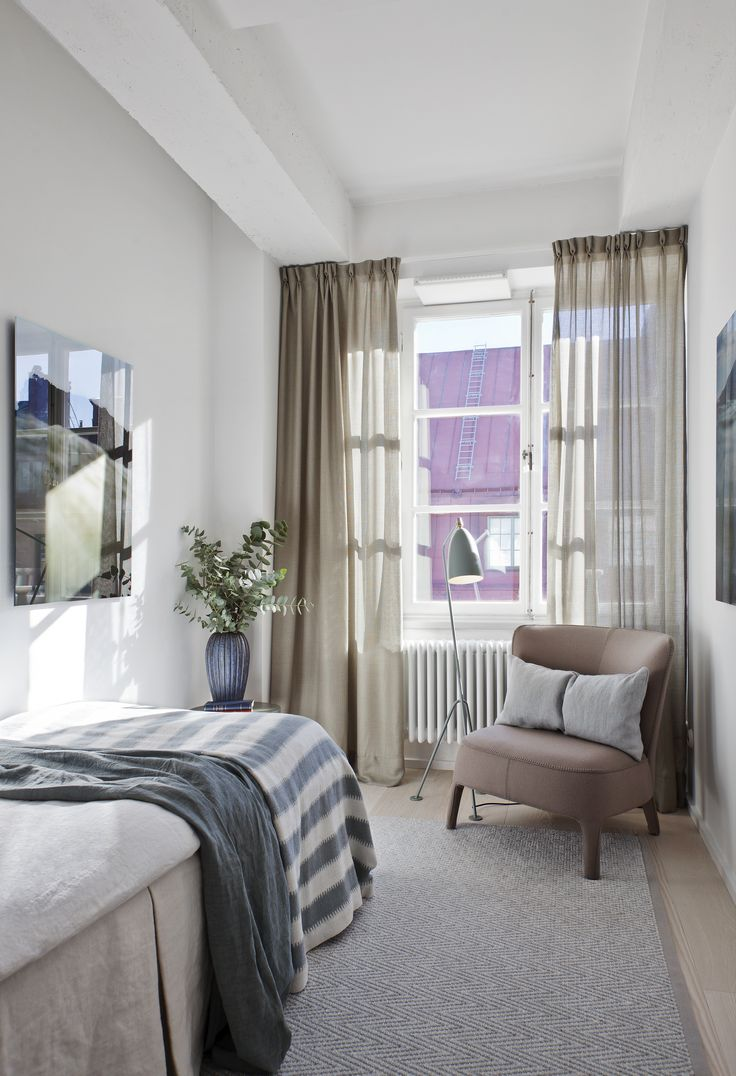 Oscar Properties: Chokladfabriken #oscarproperties  guest room, bed, armchair, curtains
