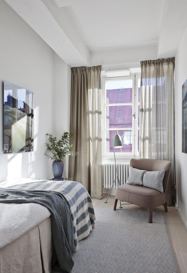 Oscar Properties: Chokladfabriken #oscarproperties  guest room, bed, armchair, curtains