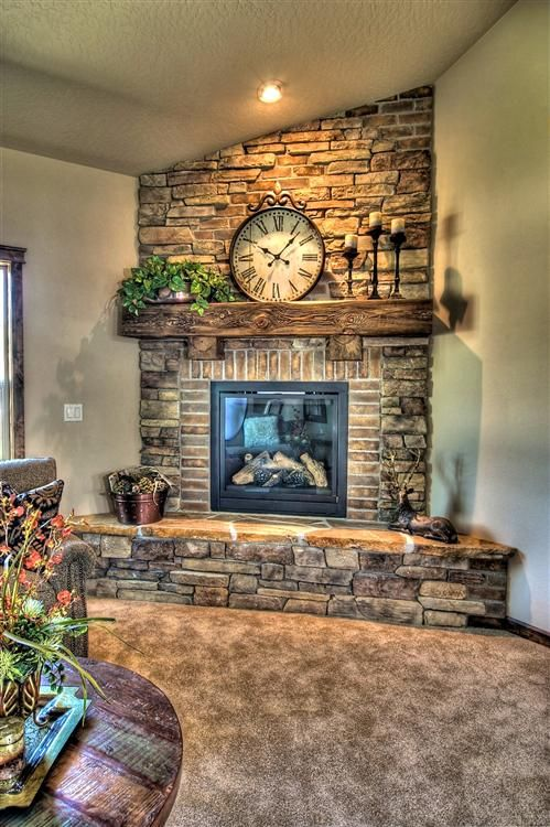 Stone and brick fireplace. This would look awesome in the corner of the living room.