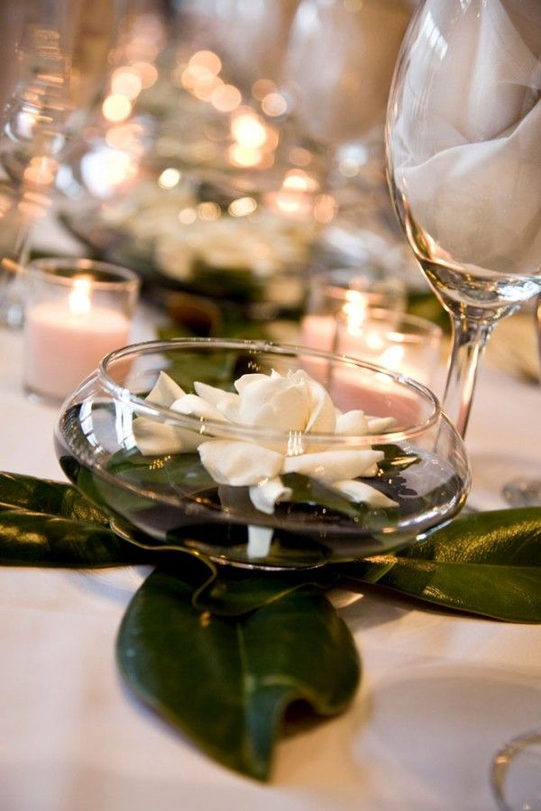 High top table centerpieces: deep dish, floating gardenia, magnolia leaves