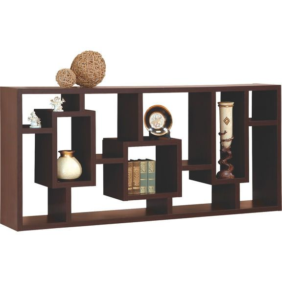 Need additional shelving? Perhaps you're seeking a modestly handsome way to display your ornaments? Create the space you need with a shelving unit with flair! The bold coffee bean finish along with its unique shelving pattern can uplift and enhance any room in your home. A beautiful addition that adds personality to your space!