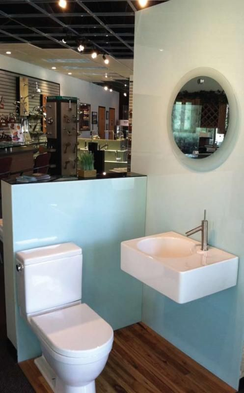 Carolina Glass & Mirror's showroom: Walls clad with back painted glass, bonded standoff mirror with sandblasted edge and Duravit European plumbing fixtures
