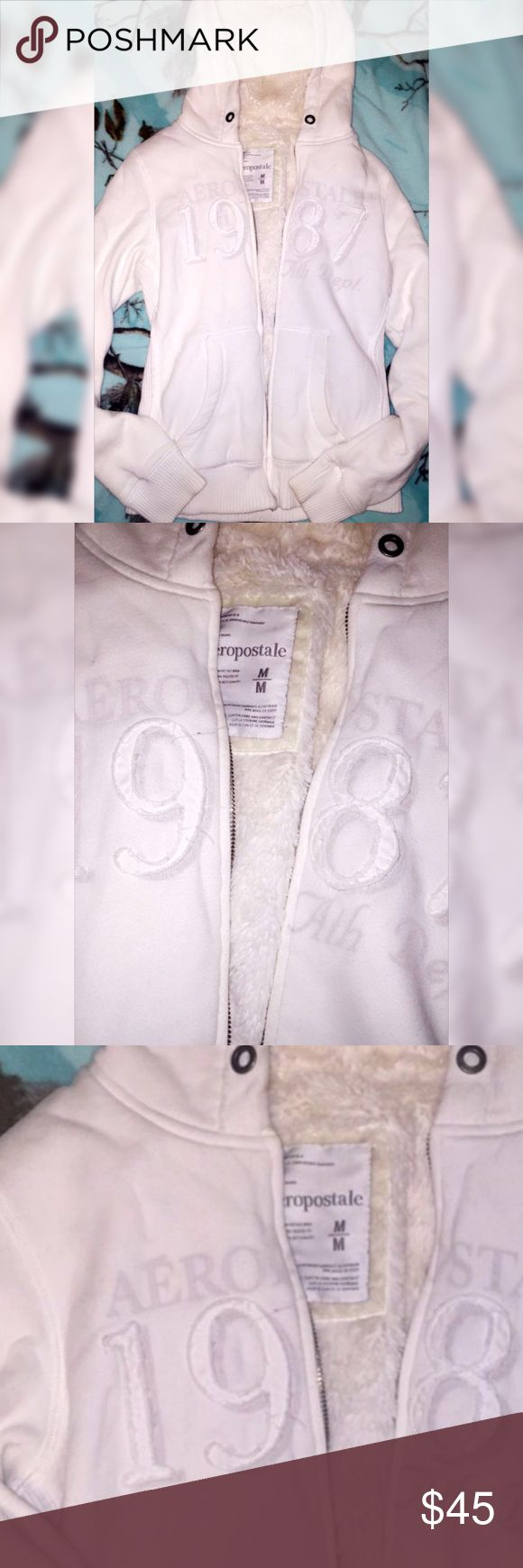 Aeropostale zip up hoodie with faux fur Cream zip up hoodie with faux fur in the inside, brand Aeropostale, size medium , in great condition , stain free Tops Sweatshirts & Hoodies