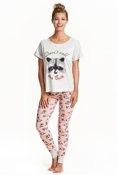 Pyjamas: Pyjamas in soft, printed cotton jersey. T-shirt top with a wide neckline and sewn-in turn-ups on the sleeves. Leggings with an elasticated drawstring waist and ribbed hems.
