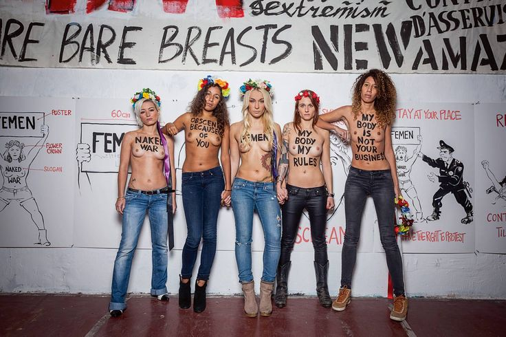 Feminist messages painted onto topless women