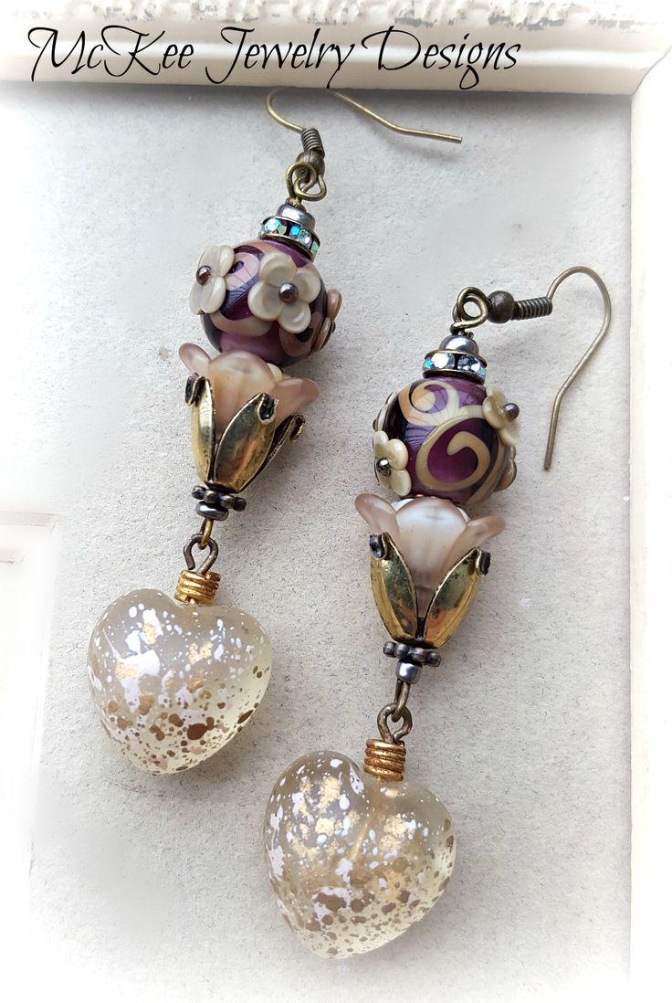 Victorian flowers. Glass lampwork, flower beads, bronze metal earrings.