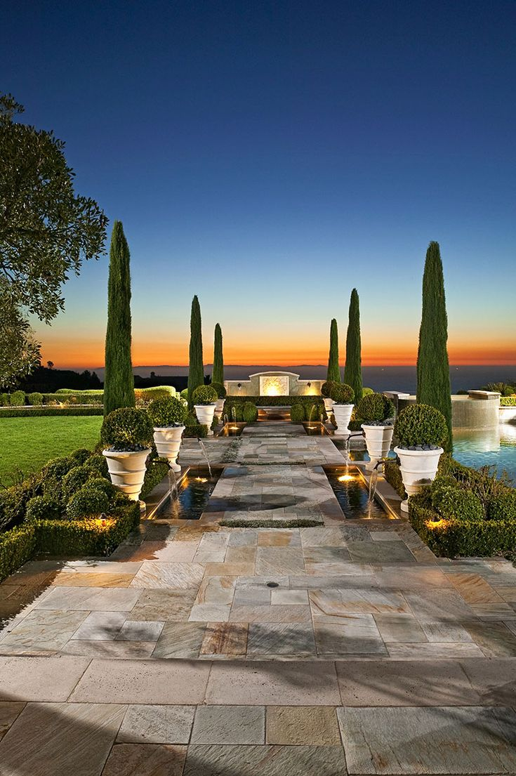 Gorgeous color in this patio by AMS Landscape Design Studio