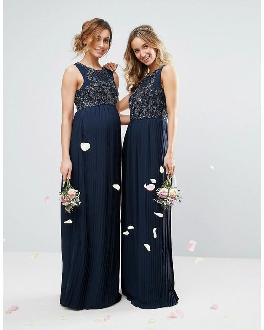 ASOS has maternity versions of many bridesmaids dresses so you can find something that fits the entire wedding party perfectly! | ASOS Maya Maternity Embellilshed Maxi Dress with Pleated Skirt | Pregnant Bridesmaid Dresses | Wedding Party Fashion | Bridal Party Style