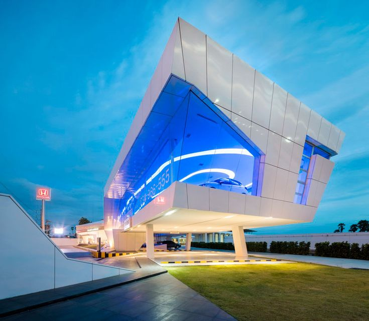 nakornchaisri honda showroom by office AT displays cars within an elevated glass façade