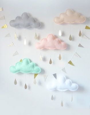 Little clouds made of felt. Cute decor for a baby shower that could be used as the baby's mobile in the nursery!