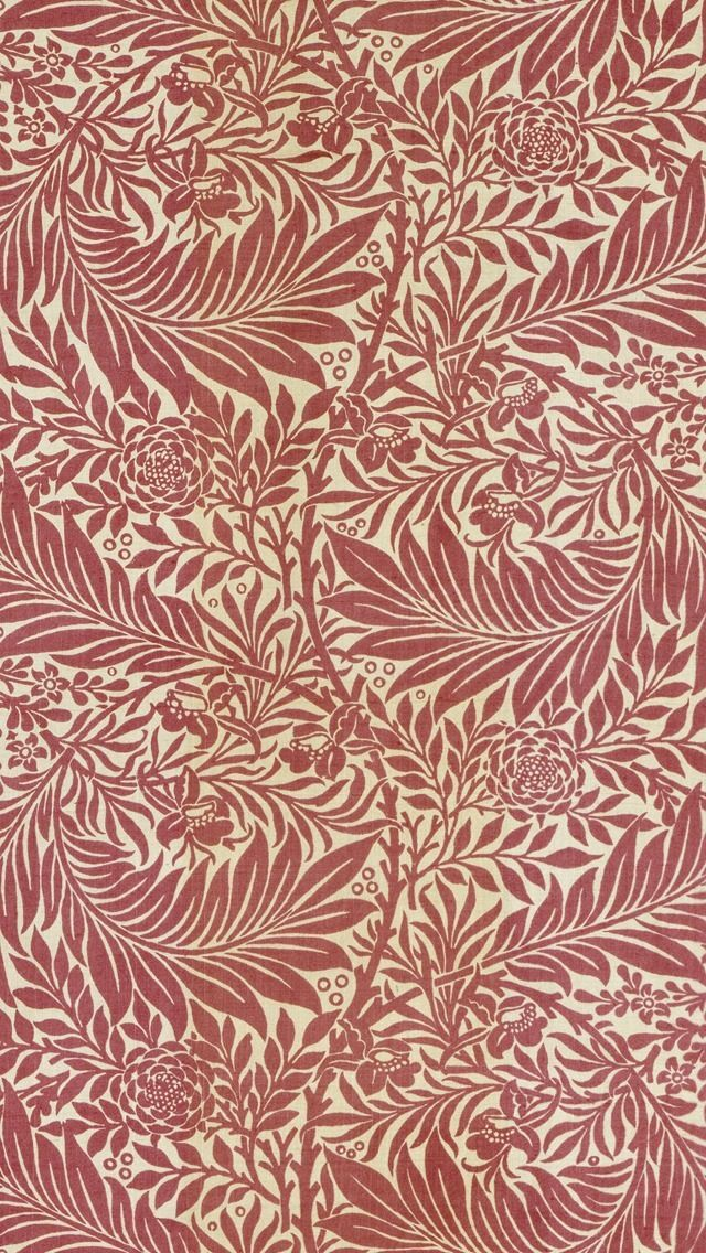 William Morris wallpaper red. It's amazing how William Morris print and rip-offs were so common a few decades ago that they went through a period of looking completely naff. Full circle now though.