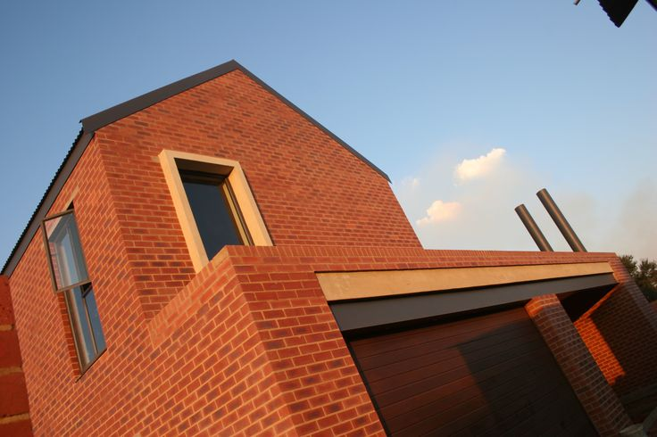 "House van der Westhuizen 2 in Pretoria, South Africa is a modern redbrick ""farmhouse"" built in an agricultural estate. Turning its back on the two parallel streets running on either side of the site, the house becomes a contemporary courtyard house. Focused living and entertaining open up into the central courtyard. Completed in 2009 by Mathews and Associates Architects. Photographed by Pieter Mathews."
