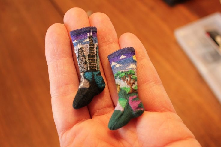 pair of miniature hand-knit socks. Image 1 of 5. Photo: Mia Partlow/WFIU  indianapublicmedia.org