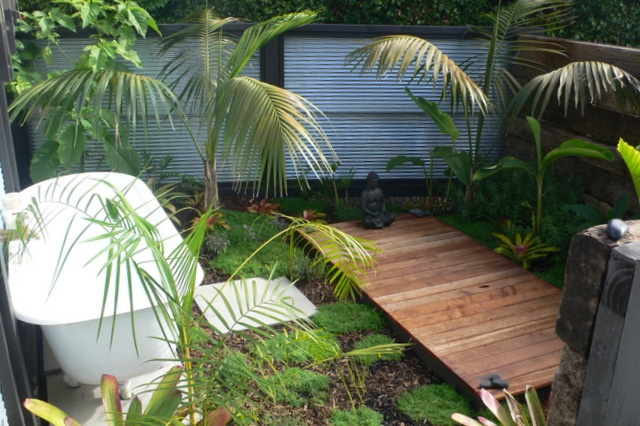 Outdoor bath and meditation subtropical garden. Complete with herb ground covers for fragrance and use in bath. Design and implementation by Fusion Landscape Design Ltd. www.fusionlandscapedesign.co.nz