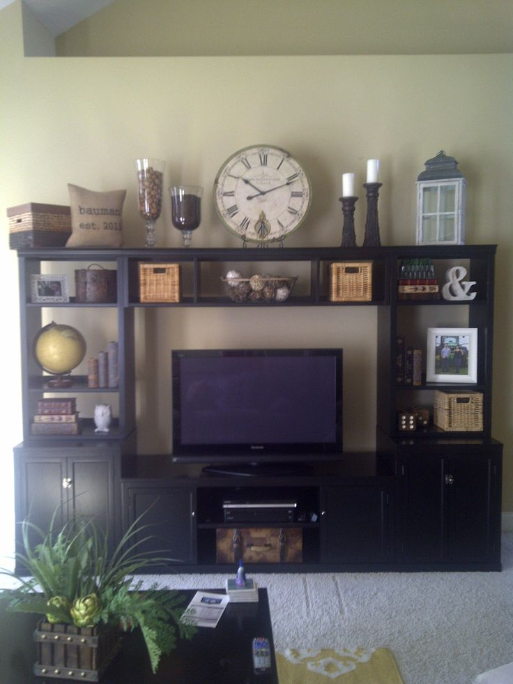 Entertainment center decorating homemaking pinterest entertainment center entertainment - How to decorate a wall unit ...