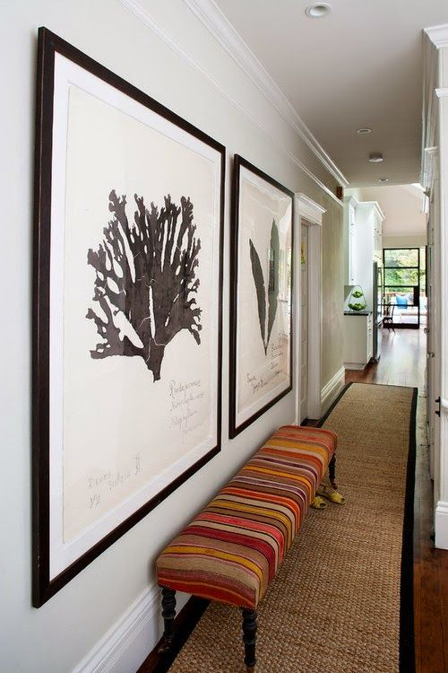 add charme to an hallway with artwork - 10 Easy tips to make your hallway look bigger