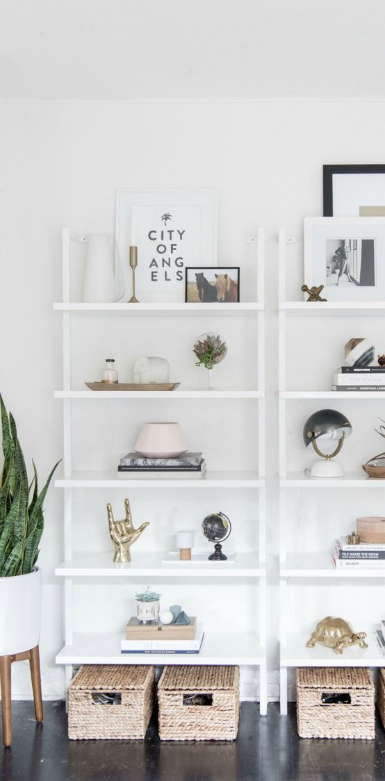 Organization and style rarely look as beautiful together as they do with this open shelving inspiration. Plus, the fresh white color scheme is a wonderful modern backdrop for your favorite decorations.