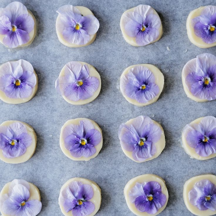 Recipe with video instructions: How to make Edible Flower Cookies.  Ingredients: 60 grams unsalted butter, softened, 30 grams confectioners' sugar, 100 grams flour, edible flowers, egg white