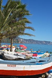 fishing boats and palm trees at Burriana Beach