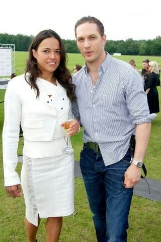 Tom with Michelle Rodriguez. Aww, I love it. Also loving his perfectly disheveled look