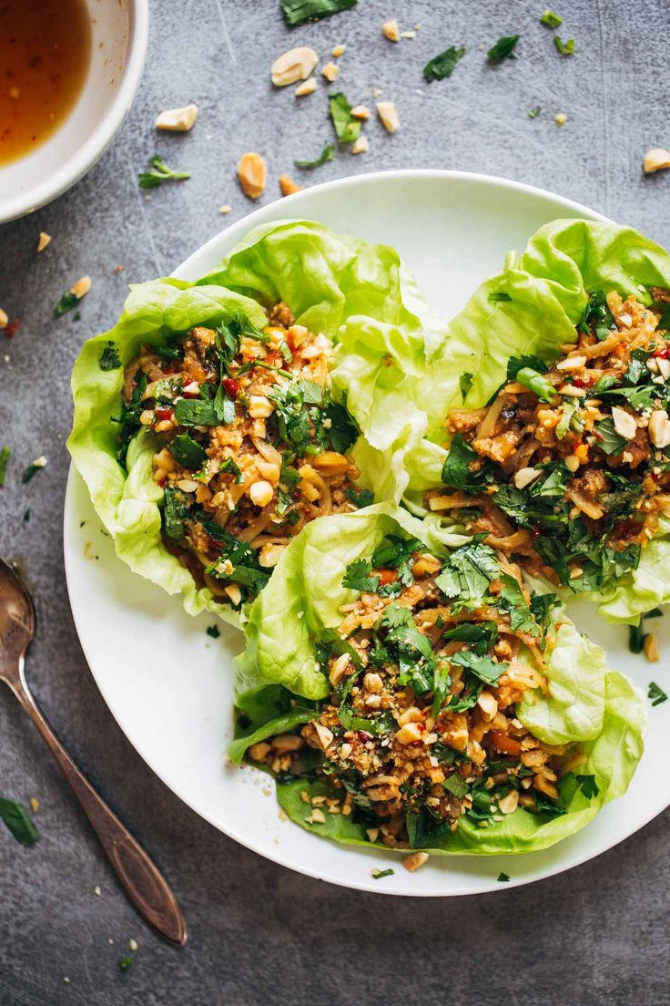 Peanut Chicken Lettuce Wraps with a Ginger Garlic sauce - ground chicken, peanuts, rice noodles, all wrapped in lettuce with extra sauce for serving!