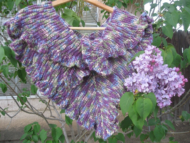 """I love Lori's triangle shawl that she made.  The ruffles are not """"me"""" but the work sure is lovely!  Nicely displayed with the blooming lilacs too!"""