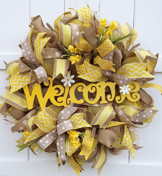 This sunny wreath can welcome your guests to your home through spring and summer! The wreath is created using a burlap jute mesh in natural and yellow. It is adorned with six different coordinating ribbons in natural, yellow, and white. The Welcome sign is MDF which is wired and hot glued. The ribbons are accented with yellow flowers. This wreath is made on a 24 inch work wreath. All of my wreaths are handmade by me! Please feel free to contact me with any questions about this wreath. Also…