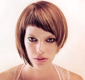 Short textured layers hair style with blunt bangs, brown