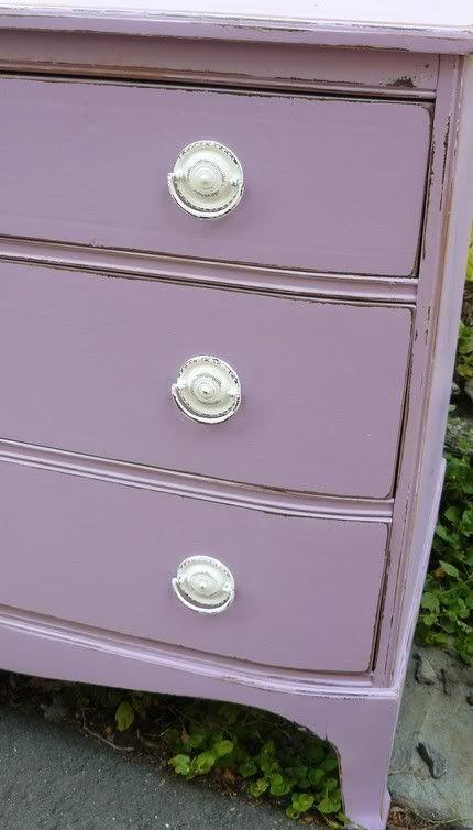 white and purple dresser-  against the dark purple wall