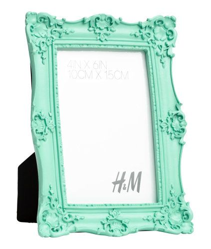Mint green. Ornately decorated acrylic photo frame. Fits photos up to approx. 4 x 6 in.