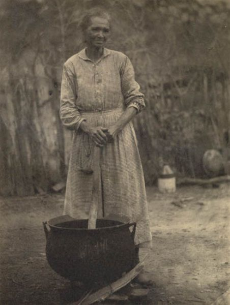 Appalachian woman. The cast iron pots served women well. They were used for washing, rendering hog fat, etc. There must have been hundreds of uses.