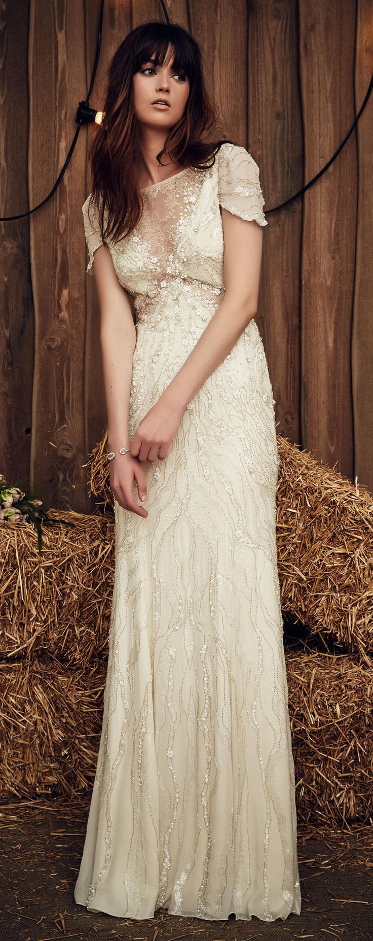 Jenny Packham Spring 2017 Nashville wedding dress with lace bodice and 3-D floral appliqués on the bodice, short sleeves and down the skirt alongside sequins and gold threading