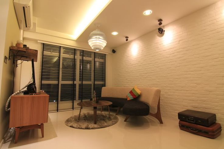 Blinds, white brick wall, ceiling mounted speakers, false ceiling with downlights.