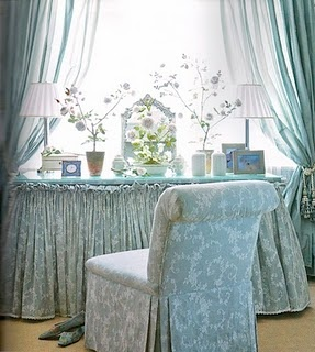 How many yards of fabric in that vanity skirt?? It's a ballgown of sorts. Love that the vanity is framed by luminous aqua draperies. Courtesy of Veranda and designed by Carolyne Roehm.