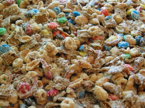 Alton once posted this on his website and said that he always cranks out a bushel or two of it during the holidays. He also said Dole this stuff out carefully. It is highly habit forming. I totally agree and for this reason have no earthly idea how many servings it makes! Depends on how much you can eat! LOL Especially good to anyone who likes the salty-sweet combination. Cooking time is cooling time.
