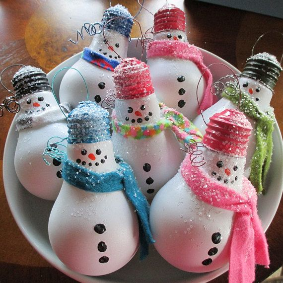 These adorable snowmen are made from recycled ligh…