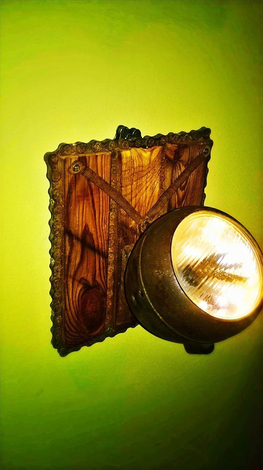 40 years old rusty bike parts wall lamp