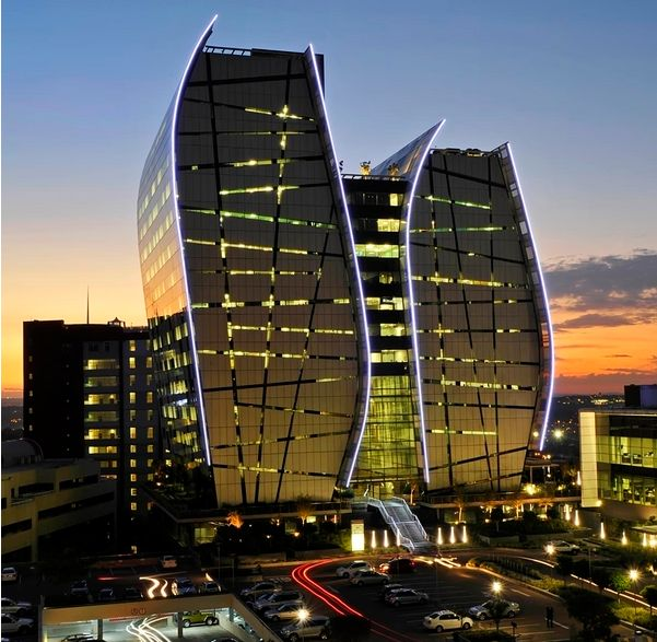 Admire the Norton Rose Fulbright South Africa building at twilight - breathtaking architecture in Sandton, Johannesburg.