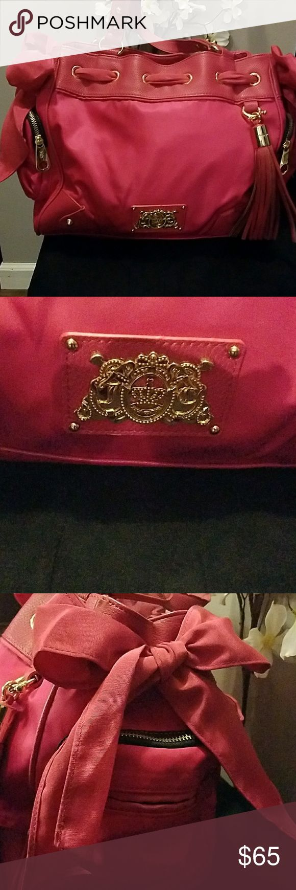 FUCHSIA JUICY COUTURE HANDBAG Authentic juicu couture handbag. Pristine condition. Each side of handbag has side zippers and adorable Bows! Juicy Couture Bags Satchels